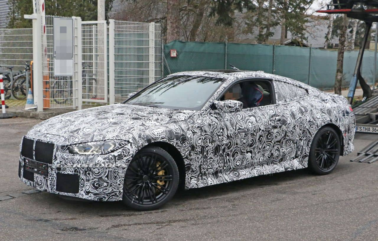 BMW M4 coupe spyshot front three quarter